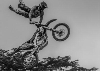 Stunt motor bike rider